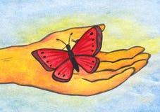 Reiki fjäril i handen (2008) Arkivfoton
