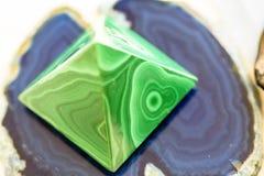 Reiki green pyramid stone used un reiky therapies royalty free stock photos