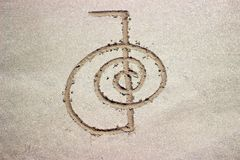 Reiki healing symbol cho ku rei on sand. Alternative medicine concept stock image
