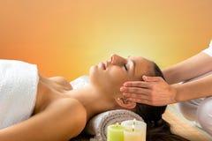 Reiki therapist doing treatment on woman. Royalty Free Stock Photo