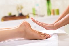 Reiki treatment. Close-up of specialist doing reiki treatment to young woman Royalty Free Stock Photo