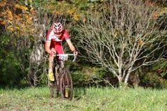 Rein Taaramäe. TARTU,ESTONIA-SEPT 30:The cyclist Rein Taaramäe, climbing in a muddy competition on September 30 2012 in Tartu, Estonia. Rein Taaramäe is an Royalty Free Stock Photos