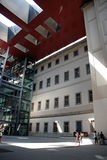 Reina Sofia. Visitors enjoy the sunlight at the imposing courtyard of the museum of contemporary art in Madrid. Funnel-like openings in the roof emphasize its Royalty Free Stock Images