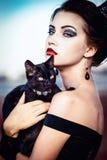 Reina y gato Imagenes de archivo