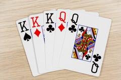Reinas de los reyes de la casa llena - casino que juega tarjetas del póker foto de archivo libre de regalías