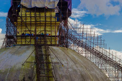 Reincarnation of Budhnath stupa. The April 2015 Nepal earthquake badly damaged Boudhanath Stupa, severely cracking the spire. As a result, the whole structure stock image