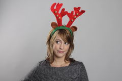 Reindeer. Woman with reindeer horns on head Stock Photography