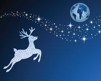 Reindeer. With red nose flying towards earth on christmas eve - starlit sky Royalty Free Stock Photo