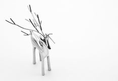 Reindeer. Shiny, silver reindeer on a white background Royalty Free Stock Photos