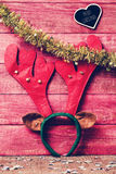 Reindeer antler headband and text merry christmas, filtered Stock Photo
