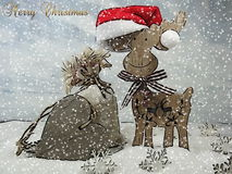 Reindeer and a bag of gifts and a wooden heart - The magic of Christmas Stock Photo