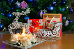 Reindeer and candle near the christmas tree Stock Photo