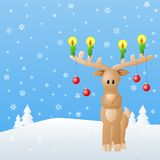 Reindeer with candles and Christmas baubles in sno Royalty Free Stock Image