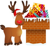 Reindeer on chimney with gifts Stock Images