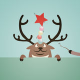 Reindeer and christmas ball Stock Images