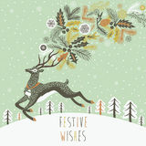 Reindeer Christmas card design. Beautiful reindeer Christmas card design with a graceful leaping reindeer on a snowy hill trailing holly and decorations from his Stock Photos