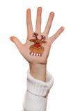 Reindeer. Christmas symbol painted on hand. Christmas background Stock Image