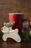 Reindeer Cookie and Coffee Cup. Stock Photos