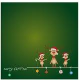 Reindeer decorating Christmas card Royalty Free Stock Photos