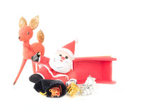 Reindeer and Drinking Santa Claus Sleigh Accident. With bag of packages spilled onto the snow white background stock image