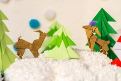 Reindeer and fir tree origami paper craft Royalty Free Stock Photos