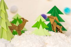Reindeer and fir tree origami paper craft Royalty Free Stock Photo