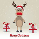 Reindeer gift snowy winter background Royalty Free Stock Photo