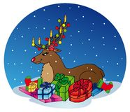 Reindeer with gifts Stock Photos