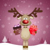 Reindeer with gifts Royalty Free Stock Photography