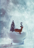 Reindeer In Glass Snow Globe Stock Image