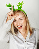 Reindeer hat on fun woman. royalty free stock images