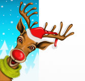Reindeer with hat of Santa Claus Stock Photos
