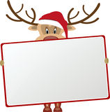 Reindeer holding blank sign Royalty Free Stock Photo