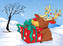 A reindeer holding a gift Stock Images