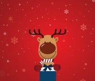 Reindeer holding giftbox Stock Image