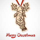 Reindeer in holiday clothes. Paper label on Royalty Free Stock Photography