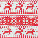 Reindeer on on knit fabric background Stock Photos