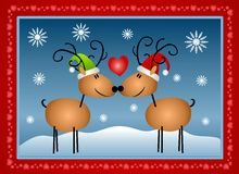 Reindeer in Love Christmas. A clip art illustration featuring a pair of reindeer in love - wearing hats with their noses touching surrounded by snowflakes and Royalty Free Stock Image