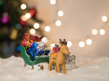 Reindeer lug green sleigh carry gift box Royalty Free Stock Images