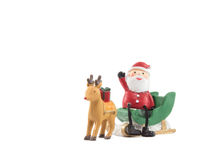 Reindeer lug green sleigh  santa claus sit on gesticulate your hand Stock Photos