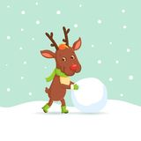 Reindeer making a snowman Royalty Free Stock Photos