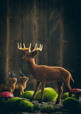 Reindeer With Moss Balls And Toadstools Royalty Free Stock Photography