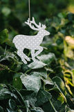 Reindeer ornament with frosty leaves Stock Photo