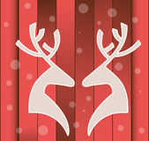 Reindeer  over planks Winter Design. Two  Reindeer  heads facing each other over planks Stock Photo