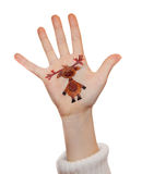 Reindeer painted on kid's hand Royalty Free Stock Photos