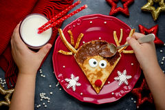 Reindeer pancakes funny and easy breakfast on Christmas. Morning meal Royalty Free Stock Photo