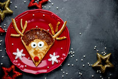 Reindeer pancakes recipe. Christmas fun food for kids. Reindeer pancake for breakfast stock photography