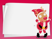 Reindeer and paper sheets Royalty Free Stock Photos