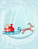 Reindeer pulling a sleigh with Christmas gifts Stock Photography