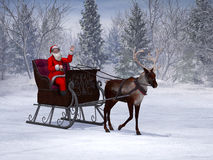 Reindeer pulling a sleigh with waving Santa Claus. Stock Photo